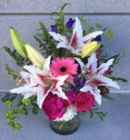Hydrangea, roses, lark spur, snap dragons, lilies and others.